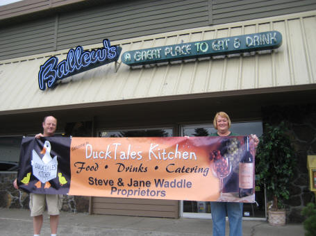 Steve & Jane Waddle hold opening day banner
